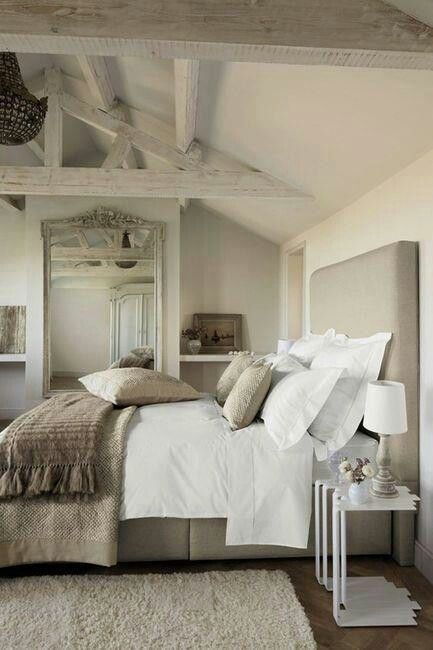 The grayscale tone to this room adds a serene peaceul feeling, the horizontal beams on the angled ceiling adds a structural addition to the overal look, however if it would be a different colour than everything else the additional height to the room would be more noticeable.