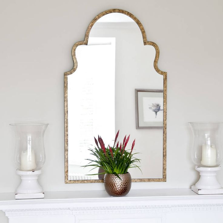 This mirror evokes a definite Moroccan feel. It has a bronze stipple effect would look stunning above a mantel.