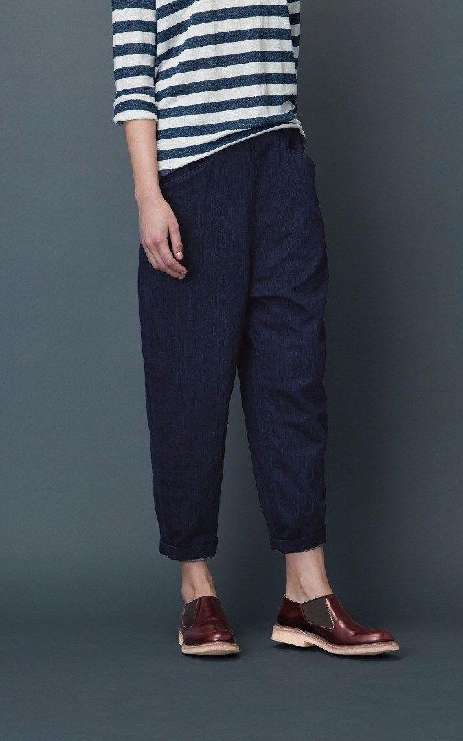 Tapered trouser in a soft, slouchy, indigo-dyed, cotton twill double cloth. Flat front waistband, elasticated at back. Dropped crotch. Belt loops. Two pockets.