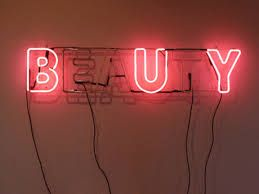 photo of neon lights, some broken , representing a hidden message with in the art work, quite simple, yet not boring