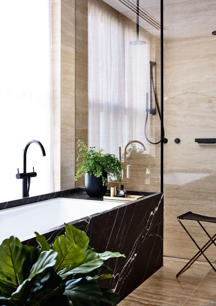 Black marble bath and green plants perfect bathroom combination