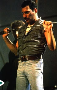 Freddie Mercury. Think this might have been from set of Princes of the Universe video.