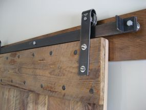 Barn door fittings -- I love the concept of not having doors swinging out and blocking hallways or creating dead space inside of a room. Barn doors can solve that!