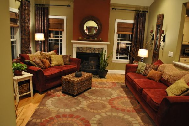 Warm cozy colors... Like the section of deep red by the fireplace. Breaks the room up.