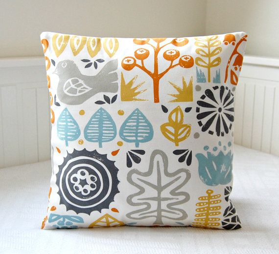 This lovely 16 inch decorative pillow cover has a light grey bird and leaves and trees in shades of teal aqua, light mustard yellow and orange on