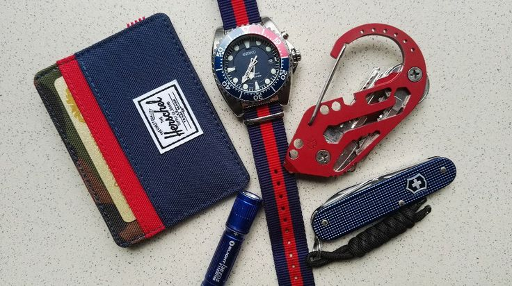 Red and Blue this summer  submitted by Victor  Herschel Supply Co. Charlie Wallet  Seiko SKA369  Olight I3E EOS  Keybiner Karabiner  Victorinox Cadet Alox