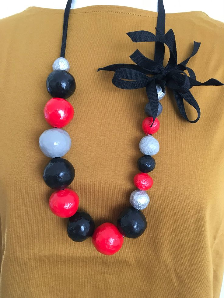 A personal favorite from my Etsy shop https://www.etsy.com/il-en/listing/535560440/paper-mache-necklace-black-red-and-gray