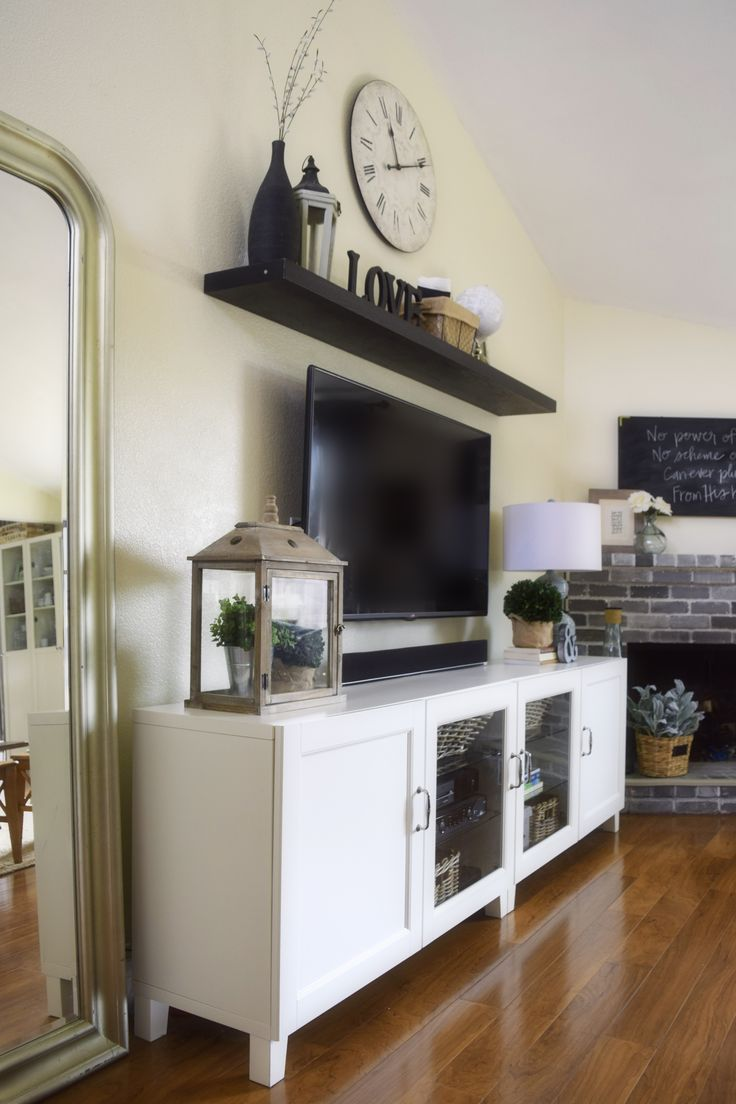 I Liked The Idea She Took 2 Smaller Cabinets And Mounted Them Together Good To Above Tv DecorLiving Room