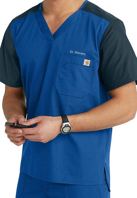 Built Carhartt strong for men's scrubs that last! This scrub top features contrast sleeves and shoulder trim with bi-swing back for ease of movement!      Tag-less neck label   Drop tail that's two inches longer than the front   Left-chest tradesmen pocket includes a pen stall   Center back length: 30