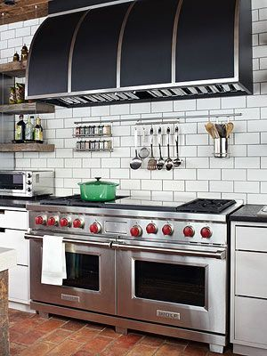 Chef's kitchen-drooling over the double ovens, grills, stove and exhaust fan over head