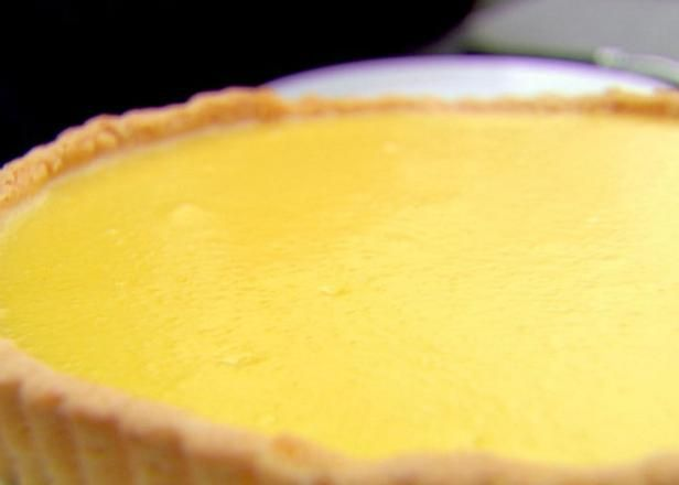 Get Lemon Curd Tart Recipe from Food Network - crust difficult to bring together, use half of sugar in curd