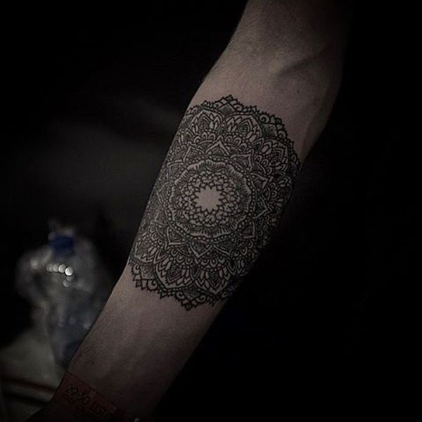 Mandala sleeve tattoo - Mandala sleeve tattoo that simply looks amazing. You can see the amount of details into the tattoo and how the centerpiece of the flower dispels all the patterns as it grabs the attention.