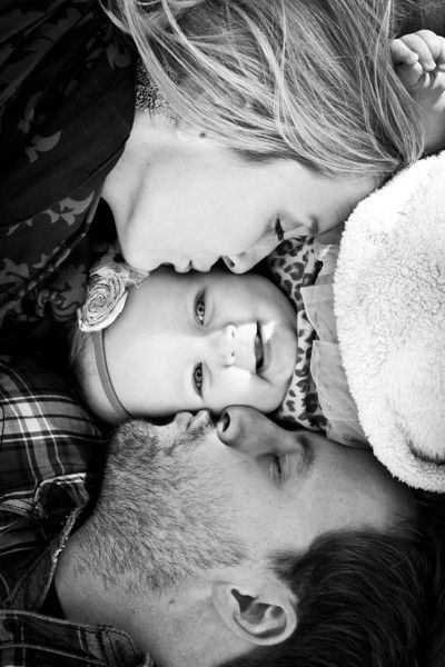 Love this photo of Mom & Dad each kissing one of the baby's cheeks. From all fore Him: Fall is finally here... *Visually I might want everyone's foreheads lined up. Try both ways to see which prefer. Family photo idea.