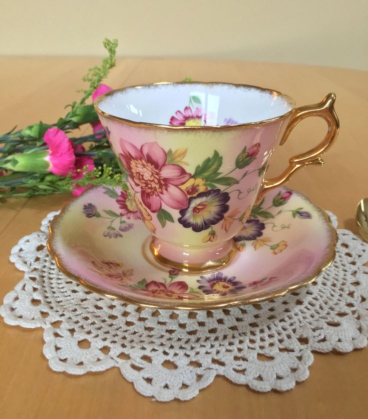 Vintage Taylor & Kent Teacup and Saucer, Pink, Purple and Yellow Flowers on a Pink and Yellow Ground, Gold Trim, Bone China - c. 1950+ by ToZoTeacups on Etsy https://www.etsy.com/listing/551170860/vintage-taylor-kent-teacup-and-saucer