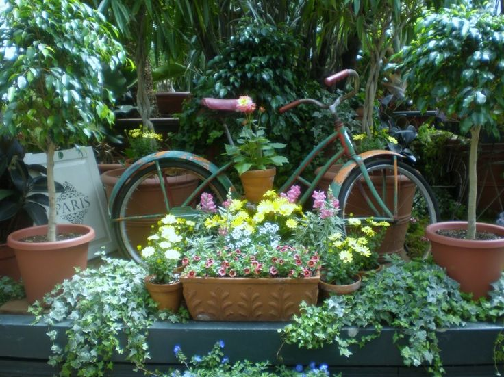 Warm and Beautiful Whimsy Garden Decorating Ideas: Beautiful Front Garden Design Ideas With Garden Flower Pots And Classic Garden Bicycle Planter ~ igiftthanks.com Landscaping Inspiration