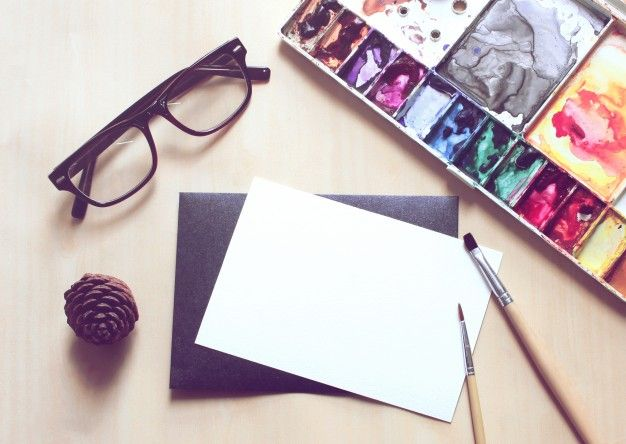Artist workspace with brush and paint on blank card, retro filter effect Free Photo