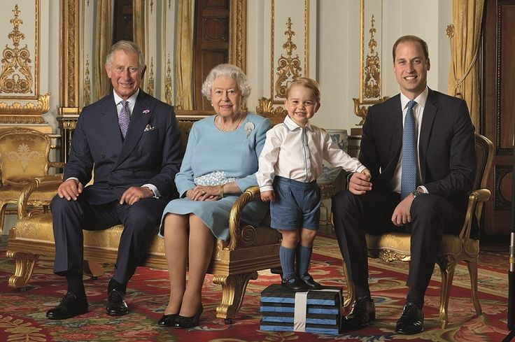 Family: Perched proudly on a pile of foam blocks, but holding daddy's hand just in case, Prince George poses for his very first postage stamp alongside his father, his grandfather – and the great-grandmother whose face has appeared on more stamps than anyone in history