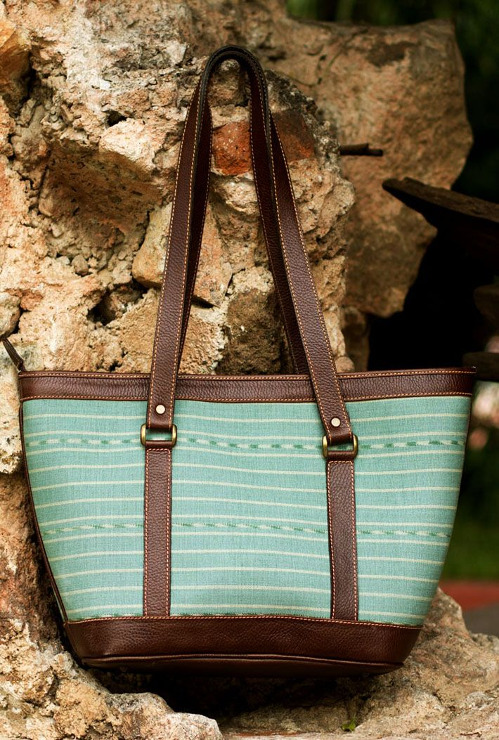 Augusto Castillo of Central America conjures a vision in mint green with subtle jaspe patterns in white that make of this shoulder #bag a most original accessory.