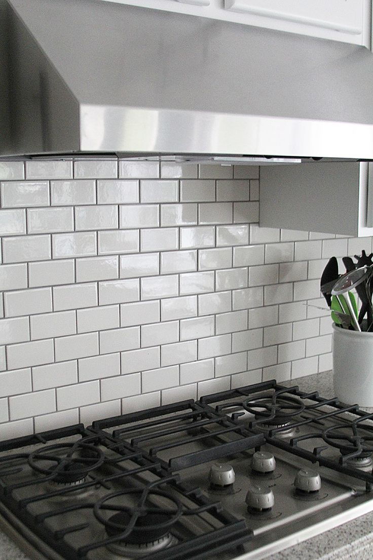 gray grout with white subway tiles helps keep the kitchen from being whitewashed - Removing Tile Backsplash