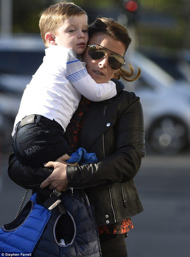 On-duty mummy: Wayne Rooney was once-again cheered on by family, as his wife Coleen brought their brood to see him captain Manchester United on Sunday