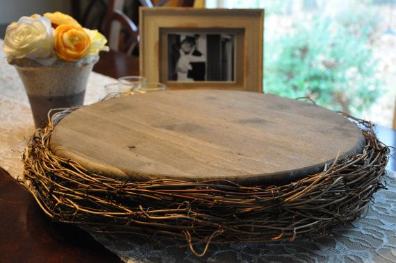 This is a gorgeous, one of a kind, handcrafted wood and grapevine cake stand. The pine wood is stained dark and distressed to look like rustic old