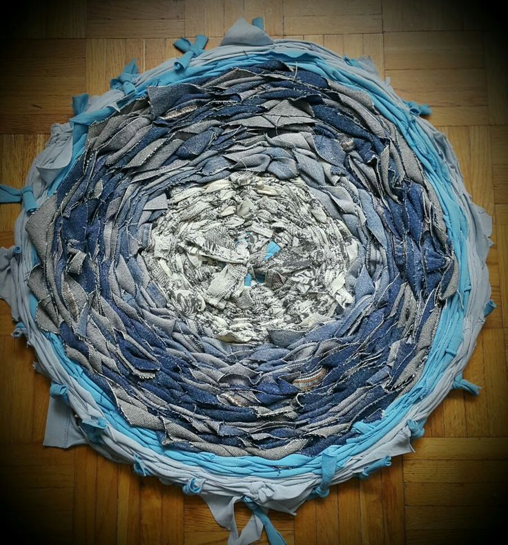 Rag rug Made on hulahoop from thisrts and old jeans.