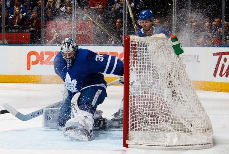 Frederik Andersen #31 of the Toronto Maple Leafs is covered in snow while playing the Columbus Blue Jackets during the second period at the Air Canada Centre on January 8, 2018 in Toronto, Ontario, Canada.