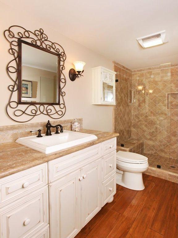 Pic On  Bathroom with Hardwood floors Swirly wall mirror Frameless Tiled shower
