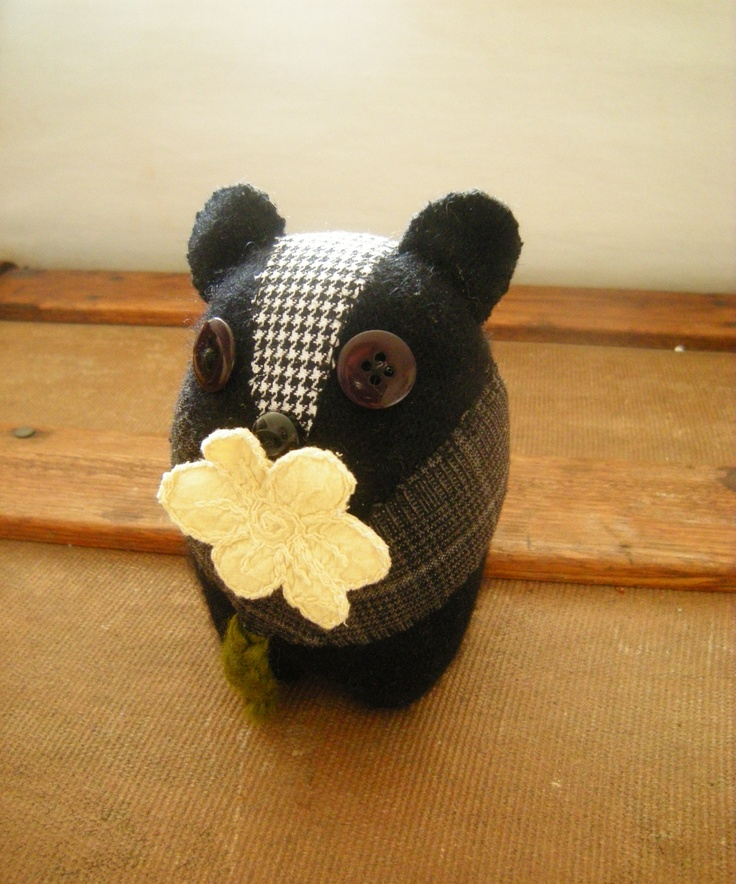 Sally the skunk is 4 inches tall and 3 inches wide she is 100% recycled material and handmade.    I once was a.......cashmere sweater, 2 different pairs of dress pants    but now I'm your.......mini skunk!