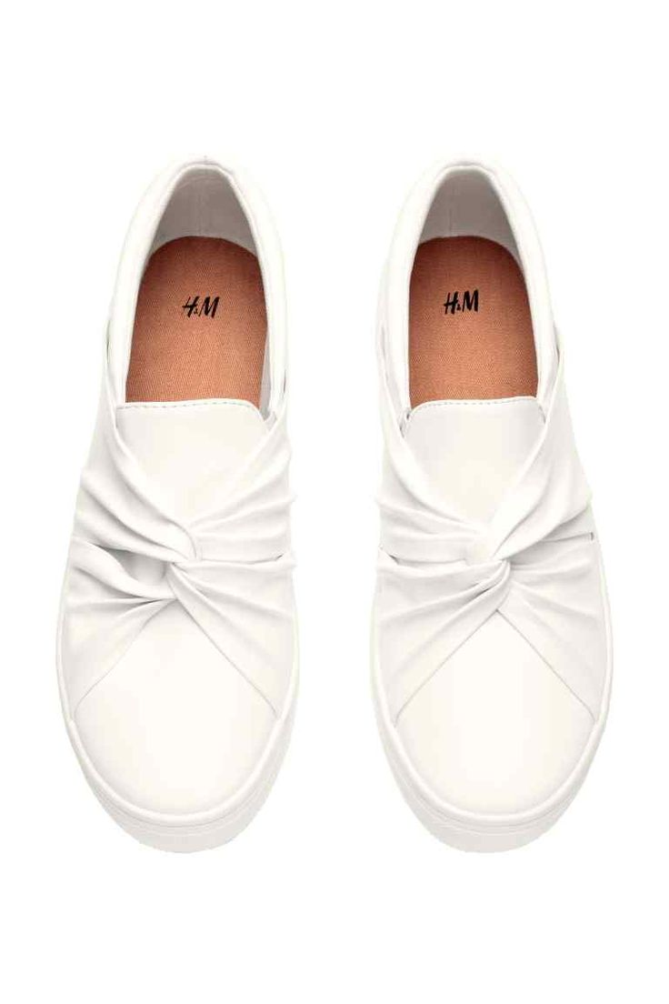 Slip-on trainers: Slip-on trainers in imitation leather with a knot detail at the front, elastic gores in the sides, fabric linings and insoles, and rubber soles.