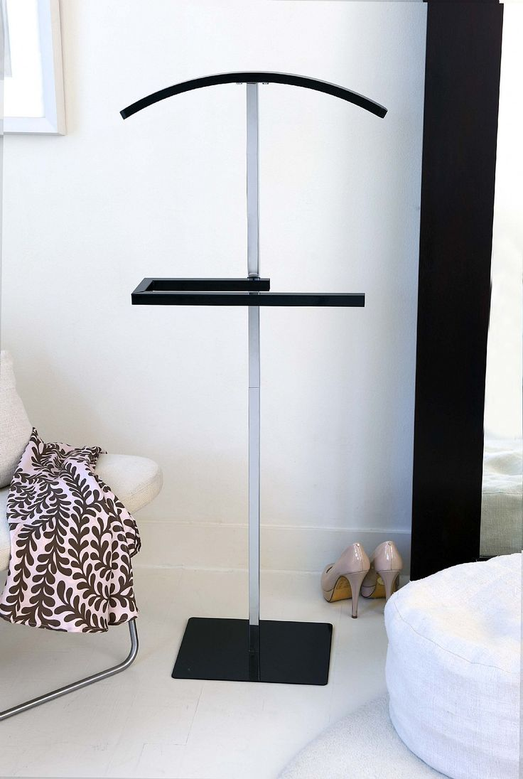 *Archives* Keep your clothes fresh, wrinkle free and ready to wear with this elegant black clothes valet stand. With its contemporary design, it will make an exceptionally stylish addition to your bedroom storage.