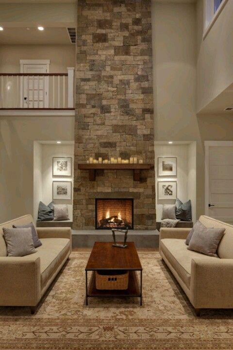 Floor to ceiling stone veneer fireplace & mantle