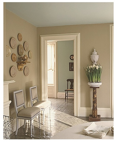 Drabware walls warm a room at night, in lamplight. The Araucana Turquoise ceiling keeps the space open and airy, while a rich cream, Silkie White, extends the walls' warmth into trim work. The floor, in Crevecoeur, has the fine gloss of dinnerware. Hallway walls beyond are Araucana Green.