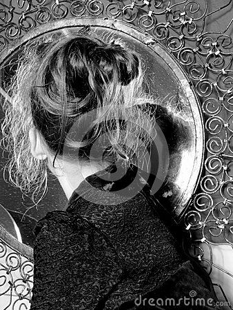 Young lady in the mirror which is observed, she is young and beautiful
