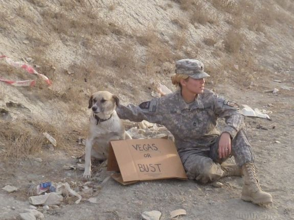 Female soldier with her dog and humor