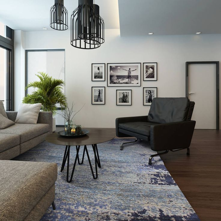 Abstract blue rug in this stylishly modern living room. | The Rug Establishment