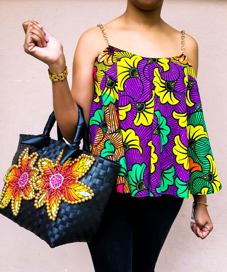 Enjoy african fashion with Mapapa's Golden chains tank top in african prints. Accessorized with an Embellished basket. shop them now on www.mapapas.com #TankTop #Fashion #Fashionable #Wax #AfricanPrints #Ankara #AfricanFabrics #Prints #Handmade #AfricanFashion #Accessories