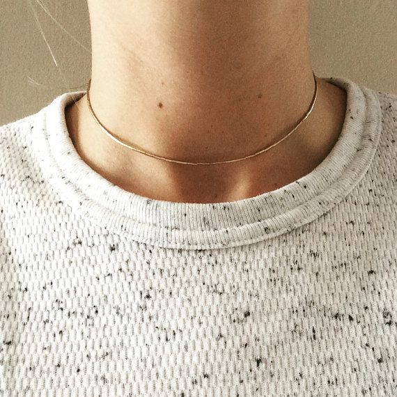 Dainty 14k gold-filled heishi beads are strung on strong wire to a choker/collar length. Perfect on its own or paired with others for a layering