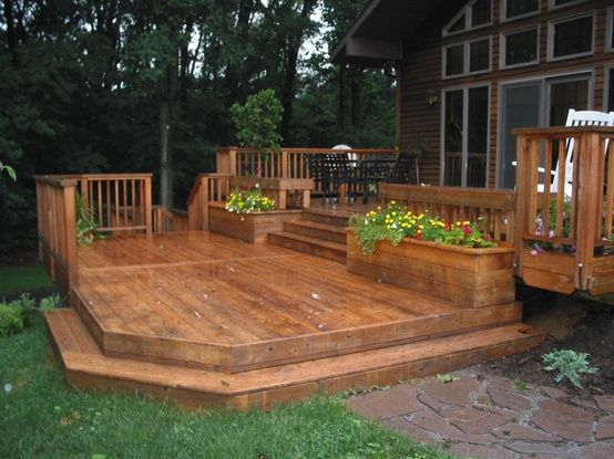 I Love tri-level decks, with curves n built in planters, maybe à pergola, some lighted wooden steps to à circular level with a jacuzzi that has à built in umbrella roof, for when it rains, you can still enjoy the moment. Need I say more???. Oh, did I say thats an add to my Dream home? À girl can dream.;)