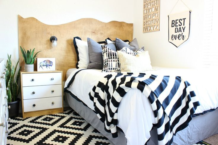 Giant wavy headboard encompassing both bed and nightstand feels cozy