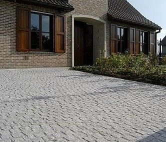 Granite #CobblestonePaving used to make a rustic old time driveway look incredible