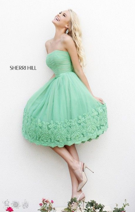 This Sherri Hill dress is one of our favorite short styles of the season! Sherri Hill 11092 is from the Sadie Robertson Live Original collection and is the perfect choice for modest girls! The knee length skirt, straight across neckline, and simple lines are beautiful and the lace detail at the bottom is an added twist we can't top gushing over! Pair with our fave, the black and white, with a red lip and stun everyone!
