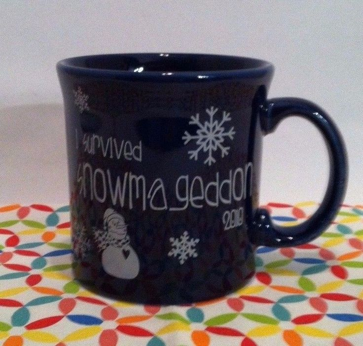"""Fiesta® Limited Edition 2010 Cobalt SNOWMAGEDDON Java Mug made by Homer Laughlin China Company.It was made to commemorate the snow packed winter of 2010. One side features a snowman, snowflakes and the phrase """"I survived snowmaggedon 2010."""" This item was made in limited numbers and is difficult to find 