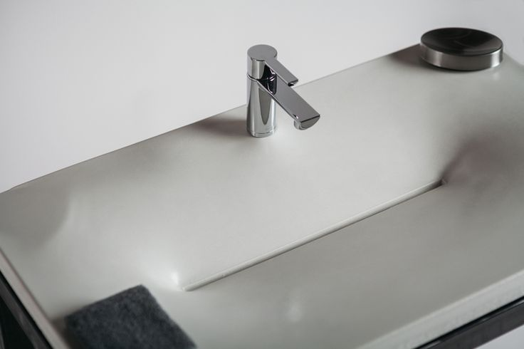 Concrete sink done with fabric form in bone white, paired with a modern faucet.