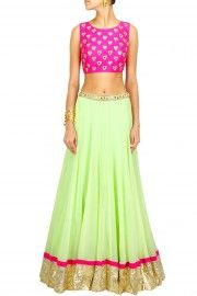 Neon pink mirror work blouse with mint green lehenga .. At a special price whats app for more details 9654478046