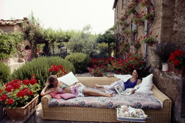 Italian author Anna Cataldi (right) and her daughter, Giacaranda Falck, relaxing on the terrace of their home in Tuscany, Italy, in July 1991. (Photo by Slim Aarons/Getty Images)