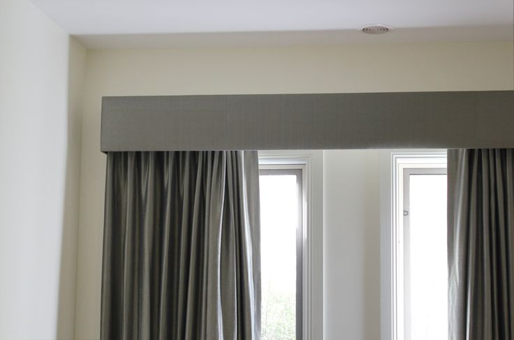 Silk fabric curtains with voile sheers and contrast straight padded pelmets.