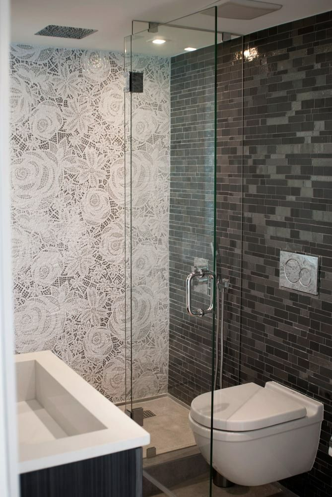 This modern bathroom has recycled glass mosaic tiles on the