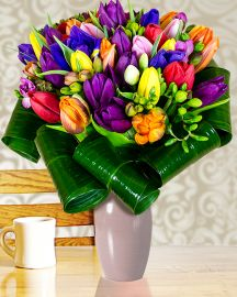 Impress a loved one with an unexpected gift: An absolutely gorgeous bouquet in cheerful colors. 33 tulips, 14 freesias and 4 irises in a symphony of colors. Order online this bouquet and send it to the person you want to bring a smile too. Flowers cheer anyone, more so if they come from someone you love. Think of those who you didn't create a little joy for a long time and choose our flower delivery service. It's too simple, not to do it!