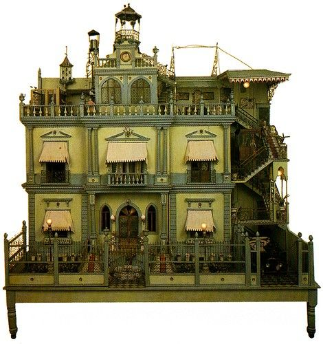 link for lots of inspirational dollhouses but this GREEN one catches my fancy.  Definitely going to bring my house back out of storage.